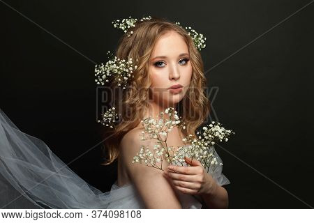 Fiancee Girl With Long Healthy Curly Hair And White Flowers On Black Background