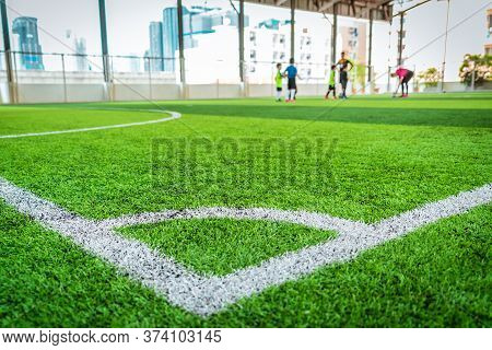 Football Corner White Line On Green Artifact Grass Of Soccer Indoor Pitch.