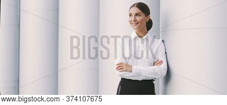 Banner Young Attractive Woman Corporate Lawyer In Suit Look At Copy Space And Smile Outdoors. Beauti