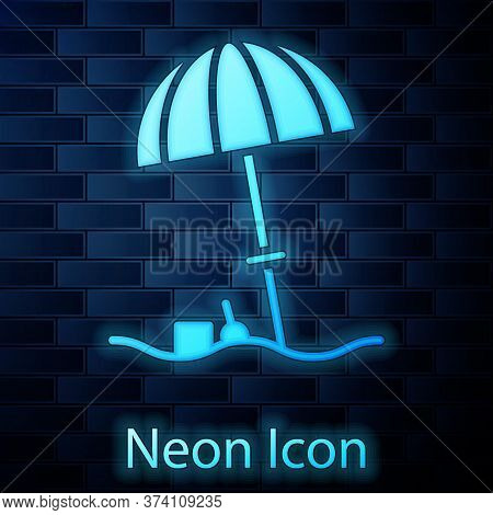 Glowing Neon Sun Protective Umbrella For Beach Icon Isolated On Brick Wall Background. Large Parasol