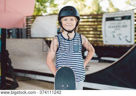 Children Boy With Skateboard, Weekend Breaks, Education Training, First Steps On Board. Skateboarder