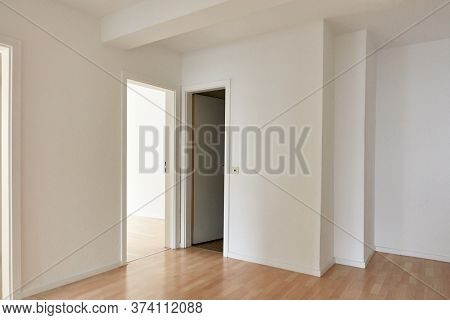 Large bright hallway as a passage room with doors to the room and toilet