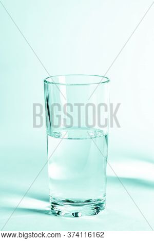 Glass With Clean Clear Water On A White Background