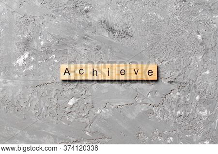 Achieve Word Written On Wood Block. Achieve Text On Cement Table For Your Desing, Concept