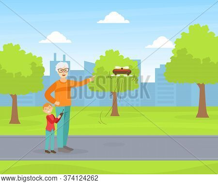 Grandfather And Grandson Operating Flying Drone In Park, Grandparent And Grandchild Having Good Time