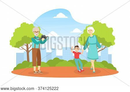 Grandfather Shooting Grandmother With Grandchild In Park, Grandparents And Grandchild Having Good Ti