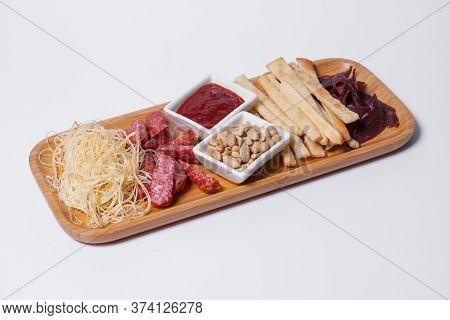 Set Of Beer Snacks With Salami, Peanuts, Cheddar Cheese And Ketchup