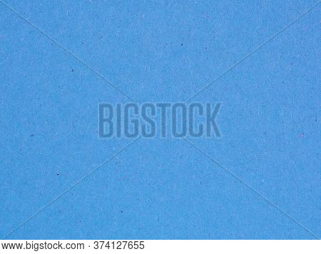 The Surface Of A Sheet Of Blue Or Azure Cardboard. Rough Natural Paper Texture With Cellulose Fibers