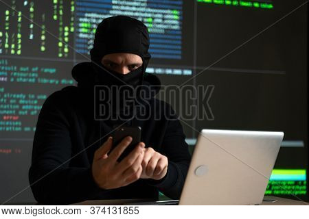 Hacker Uses A Mobile Phone To Hack The System. Stealing Personal Data And Money From Bank Accounts.