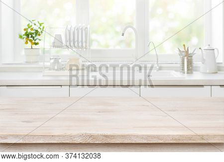 Wooden Table On Blurred Backgrounds Of Kitchen White Sink Window