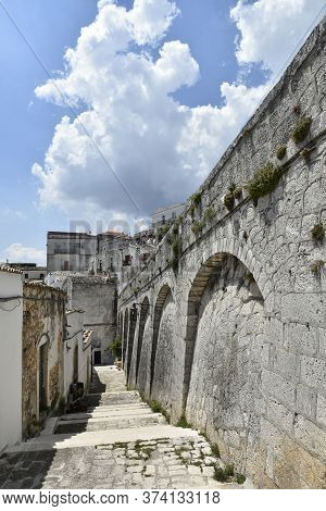 A Narrow Street In The Old Town Of Monte Sant'angelo In The Puglia Region, Italy.