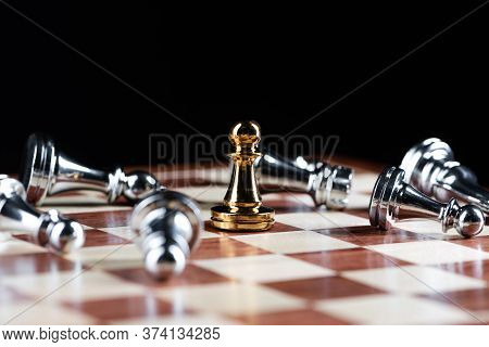 Gold Pawn Chess Defeats Silver Figures On Wooden Chessboard. Intellectual Duel And Tactical Battle I