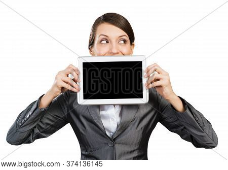 Businesswoman With Tablet Computer Looking Away. Portrait Of Attractive Woman In Formalwear Showing