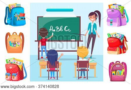 Children Learning Alphabet At School Lesson With Teacher. Boy Standing Near Blackboard With Chalk An