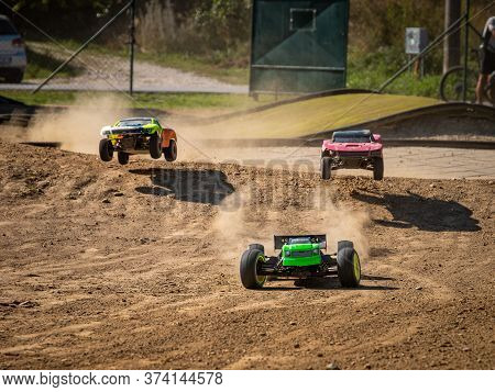 Three Offroad Rc Cars Racing On A Track