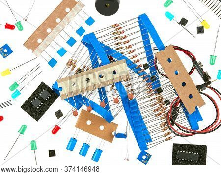 A selection of active and passive electronics components: buttons, LEDs, resistors, capacitors, buzz