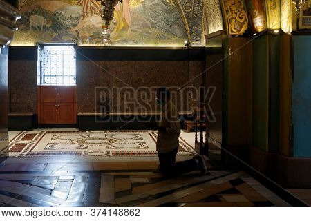 Jerusalem, Israel, June 13, 2020 : The Believer Man Kneels And Prays In The Church Of The Holy Sepul