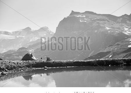 Magnificent Landscape Of Blue Lake And Tourist Tent In The Mountain Valley. Majestic Rocky Hills And