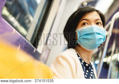 Beautiful Asian Woman In Protective Face Mask For Protection Coronavirus Or Covid-19 Or Air Pollutio