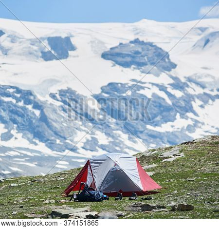 Beautiful View Of Mountain Valley With Tourist Tent And Hiker Belongings. Picturesque Scenery Of Cam