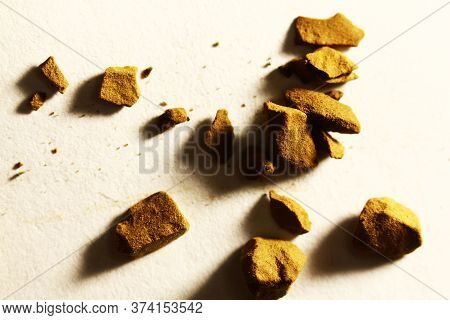 Instant Coffee Granules On A Light Background. Macro Shot.