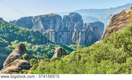 Panoramic view of rocks in Meteora in Greece with ancient Rousanou nunnery on the cliff - Picturesque greek landscape