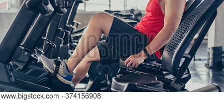 Man Bike Exercise In The Fitness Gym. Workout Alone And Solo Sport For New Normal Lifestyle. Wellnes