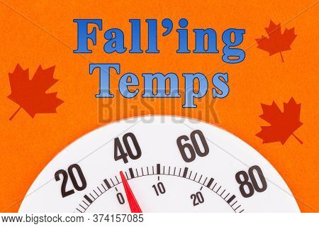 Falling Temps Word Message With Closeup Of A Thermometer At 40 Degrees With Leaves With A Bright Ora