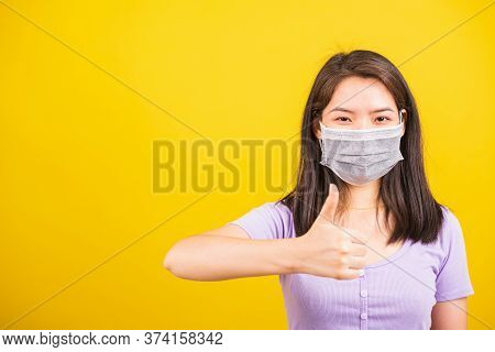 Asian Adult Woman Wearing Red Shirt And Face Mask Protective Against Coronavirus Or Covid-19 Virus O