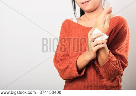 Close Up Hand Of Asian Woman She Using Wet Tissue Paper Wipe Cleaning Her Hands, Studio Shot Isolate