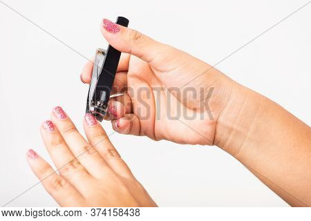 Close Up Young Asian Woman Have Tool Cutting Nails Fingernails On Finger Using A Nail Clipper. Femal