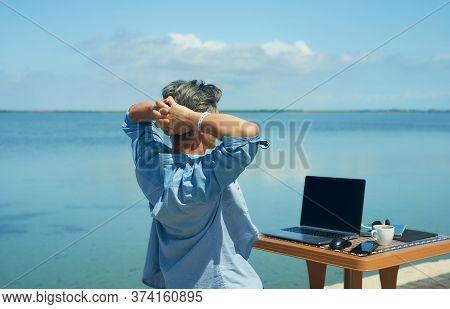 Back View Happy Freelancer Enjoying Morning By Sea At Beach. Freedom, Remote Job