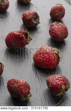 Spoiled Strawberry Flat Lay. Ironic Market Food Photos. Stale Foods Can Be Beautiful. Vertical Photo