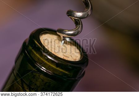 Extremely Close Up View Of Bottleneck Of Wine Bottle And Bottle-screw Swirling Cork. Wine Bottle Ope