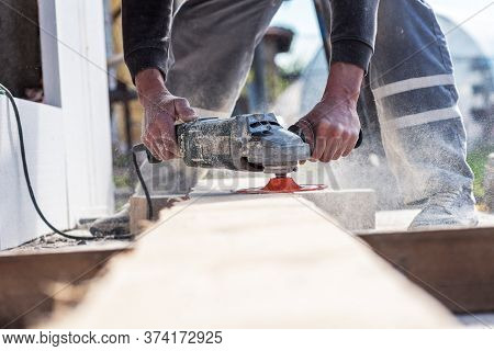The Man Works With His Hands, Grinds The Disk Around For The Grinder, The Electric Tool For Grinding