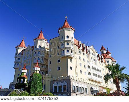 Sochi, Russia Summer 2020. Sochi Park Hotel Bogatyr On Blue Sky Background. Quarantine Coronavirus.