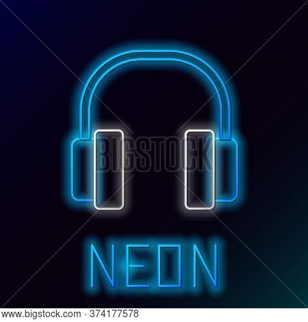 Glowing Neon Line Headphones Icon Isolated On Black Background. Earphones. Concept For Listening To