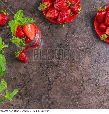 Ingredient For Homemade Strawberry Jam Or Marmalade In Glass Jar With Ripe Sweet Berries And Mint Le