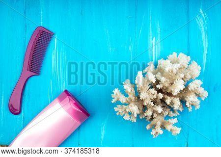 Pink Flip Flops, Corals, Slave, Sunscreen, Starfish , Summer Background. Top View.