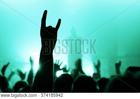 Hand With A Goat Sign Of Dancing Punk From The Crowd At A Rock Concert Of A Popular Band