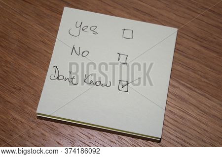 Yes No Don't Know Written On Note Shows Person Has No Clue Has A Poor Understanding And Cannot Answe