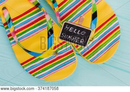 Fashion Beach Flip Flops With Little Chalkboard On Azure Background. Multicolor Lines On Flip-flops.