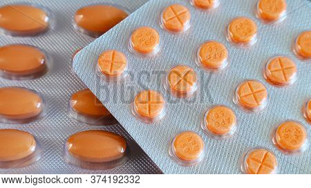 Medicines Orange Round And Oval Pills In A Blister Close-up