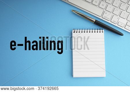 E Hailing Text With Fountain Pen, Keyboard And Notepad On Blue Background. Transportation And Busine