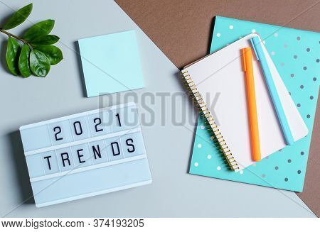 Trend Concept 2021, Light Box With Inscription, Notebook Records, Pens, Flower.