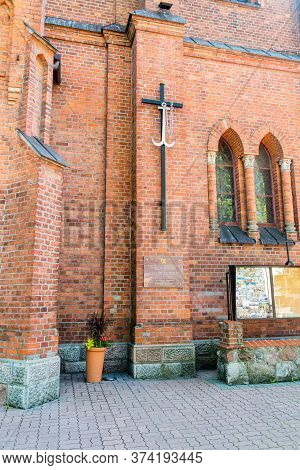 Ostrow Mazowiecka, Poland - June 2, 2020: Cross And Plaque On The Church Commemorating The Marriage