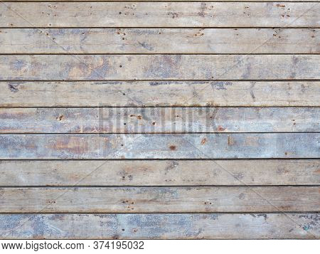 Dirty Surface From Old Unpainted Floorboards With Stains Of Rust, Paint, Engine Oil And Lime. The Bo