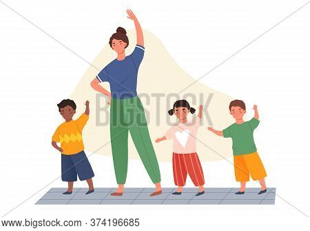 Teacher And Three Diverse Young Kindergarten Kids Exercising Doing A Work Out Indoors In An Educatio