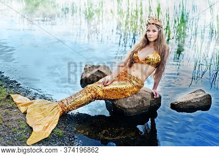 Fantasy Woman Real Mermaid Myth Goddess Of Sea With Golden Tail Sitting In Sunset On Rocks.. Gold Ha