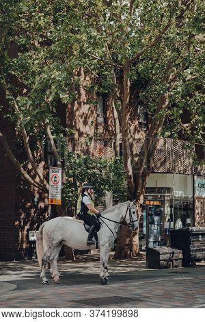 London, Uk - June 13, 2020: Horseback Police Guards Patrolling Empty Street In Covent Garden, A Typi